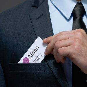 Man putting business card in to breast pocket